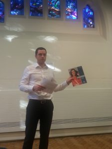 Toastmaster of the meeting Robert showing the Competent Communicator manual