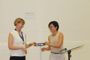 Yumi winning Best Speaker
